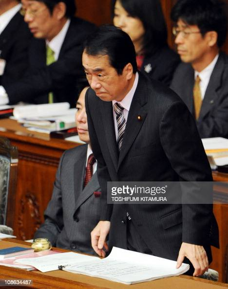 Japanese Prime Minister Naoto Kan bows during his policy speech at the lower house of the parliamentin Tokyo on January 24 2010 Kan suggested the...