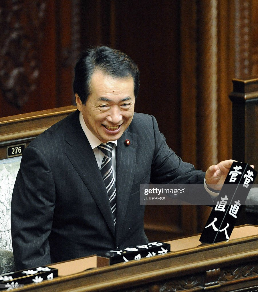 Japanese Prime Minister Naoto Kan smiles as he attends a plenary session of the Lower House at the National Diet in Tokyo on June 16, 2010. Kan easily survived a no-confidence motion after bitter exchanges in parliament kicked off campaigning for an upper house election next month.