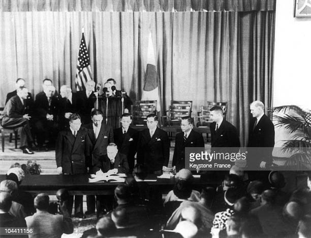 Japanese Prime Minister Shigeru YOSHIDA signs the peace treaty in San Francisco 48 countries signed the document but some major countries did not...