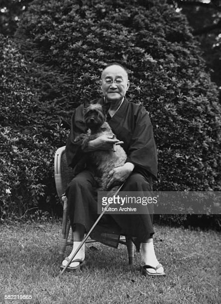 Japanese prime minister Shigeru Yoshida with a dog circa 1950