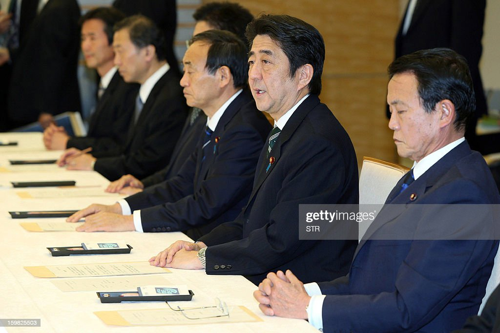 Japanese Prime Minister Shinzo Abe (2R), accompanied by Deputy Prime Minister Taro Aso (R), attends a cabinet-level meeting to co-ordinate its response to hostage issues in Algeria at the prime minister's official residence in Tokyo on January 21, 2013. Abe said seven Japanese deaths had been confirmed in the Algerian hostage crisis, the first official confirmation from Tokyo that any of its nationals had died. AFP PHOTO / JIJI PRES JAPAN OUT