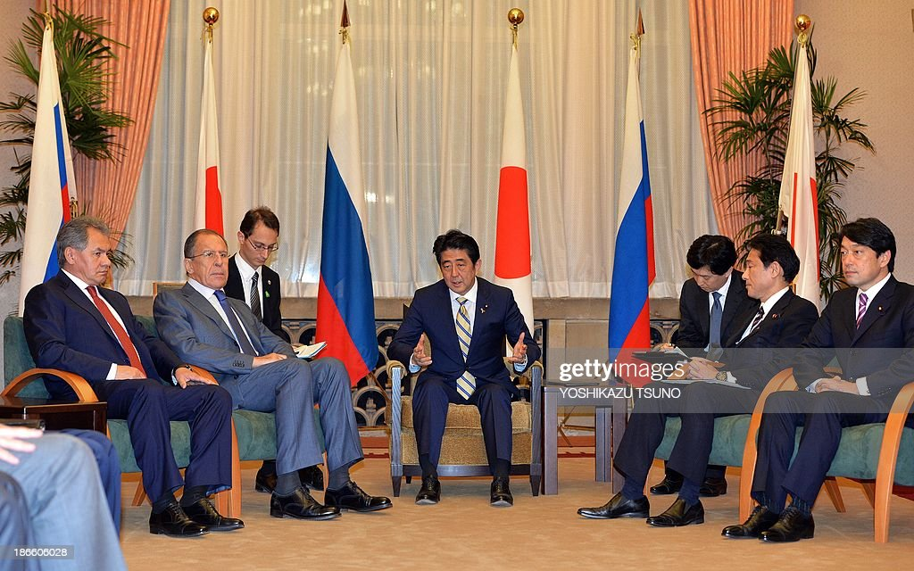 Japanese Prime Minister Shinzo Abe (C), accompanied by Japanese Foreign Minister Fumio Kishida (2nd R) and Defense Minister Itsunori Onodera (R) meet with Russian Foreign Minister Sergey Lavrov (2nd L) and Russian Defense Minister Sergei Shoigu (L) at the prime minister's residence in Tokyo on November 2, 2013. AFP PHOTO / POOL / Yoshikazu TSUNO