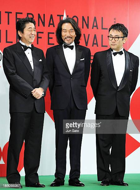 Japanese prime minister Shinzo Abe actor Koji Yakusho and director Koki Mitani attend the 26th Tokyo International Film Festival Opening Ceremony at...