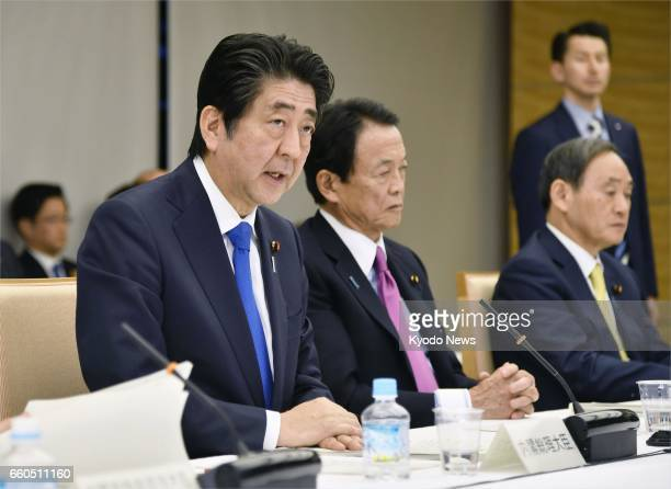 Japanese Prime Minister Shinzo Abe addresses a meeting of the Council on Economic and Fiscal Policy at the prime minister's office in Tokyo on March...