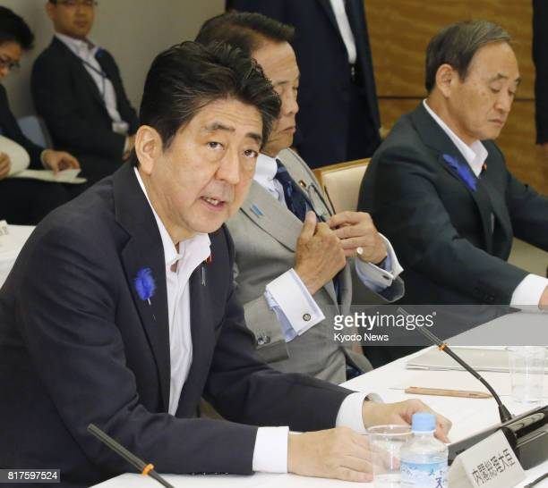Japanese Prime Minister Shinzo Abe addresses a meeting of the Council on Economic and Fiscal Policy at the prime minister's office in Tokyo on July...