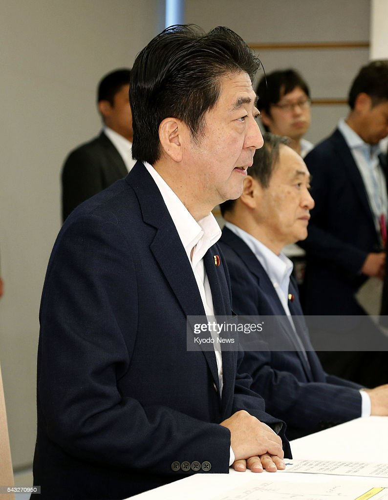 Japanese Prime Minister <a gi-track='captionPersonalityLinkClicked' href=/galleries/search?phrase=Shinzo+Abe&family=editorial&specificpeople=559017 ng-click='$event.stopPropagation()'>Shinzo Abe</a> addresses a meeting with the Bank of Japan at his office in Tokyo on June 27, 2016. Abe instructed the central bank to ensure stability in financial markets, after the previous week's decision by British voters to leave the European Union fueled uncertainty over the global economy and sparked selling of stocks worldwide.