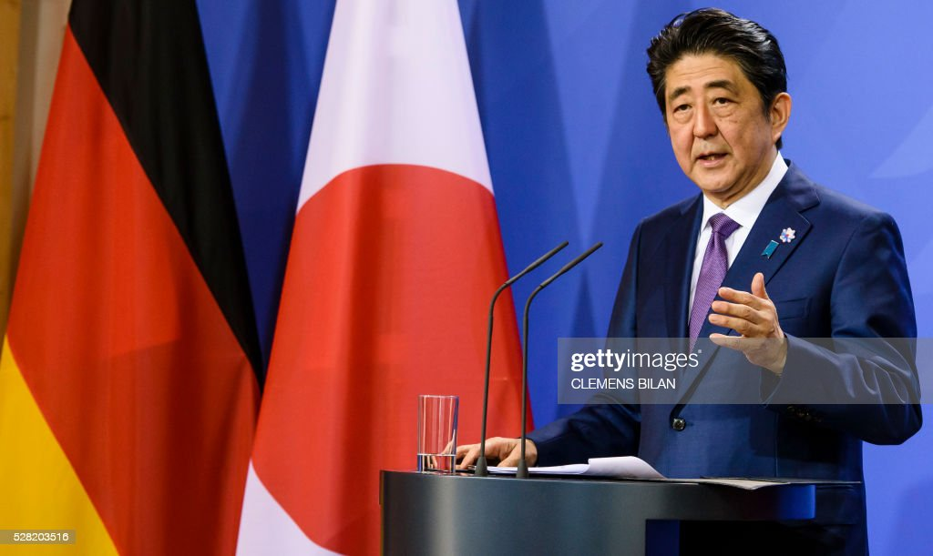 Japanese Prime Minister Shinzo Abe addresses a press conference after bilateral talks with German chancellor at the state guest house 'Schloss Meseberg' in Gransee in Brandenburg near Berlin, on May 4, 2016. / AFP / CLEMENS
