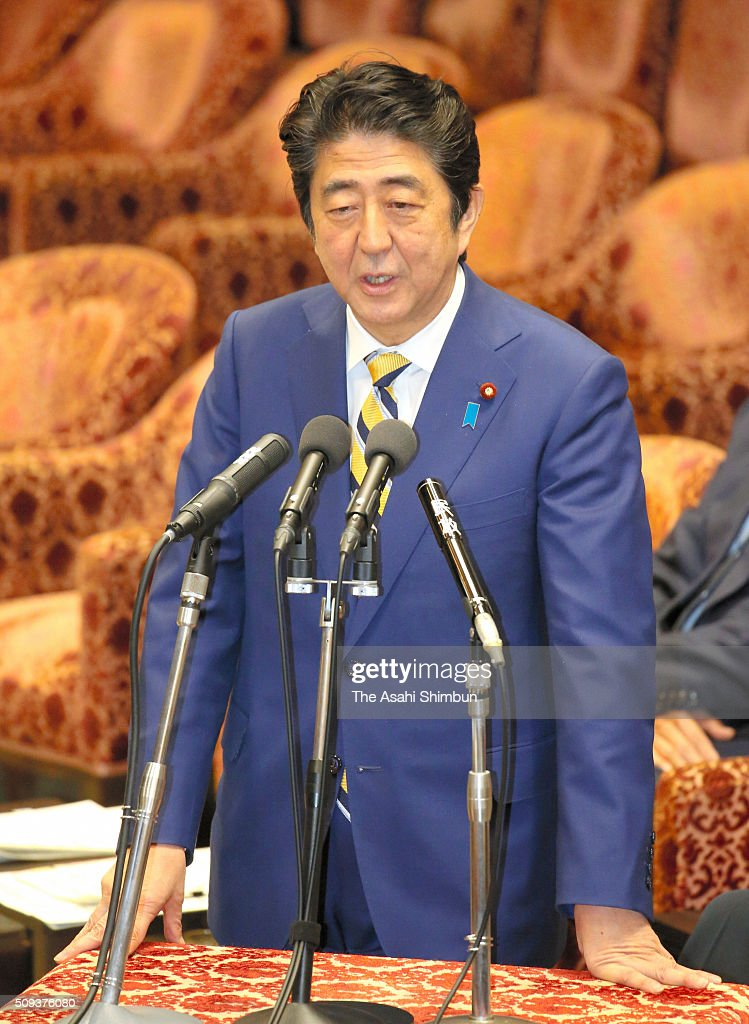 Japanese Prime Minister <a gi-track='captionPersonalityLinkClicked' href=/galleries/search?phrase=Shinzo+Abe&family=editorial&specificpeople=559017 ng-click='$event.stopPropagation()'>Shinzo Abe</a> addresses during a lower house budget committee session at the diet building on February 10, 2016 in Tokyo, Japan.