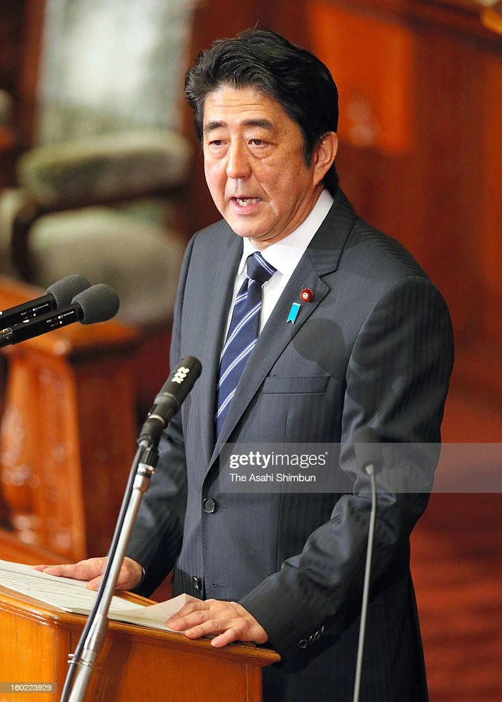 Japanese Prime Minister <a gi-track='captionPersonalityLinkClicked' href=/galleries/search?phrase=Shinzo+Abe&family=editorial&specificpeople=559017 ng-click='$event.stopPropagation()'>Shinzo Abe</a> addresses his policy speech in the lower house on January 28, 2013 in Tokyo, Japan. Abe sets his government's immediate priorities are 'economic recovery', 'restoration from the earthquake and the tsunami' and 'diplomacy and safety assurance'.