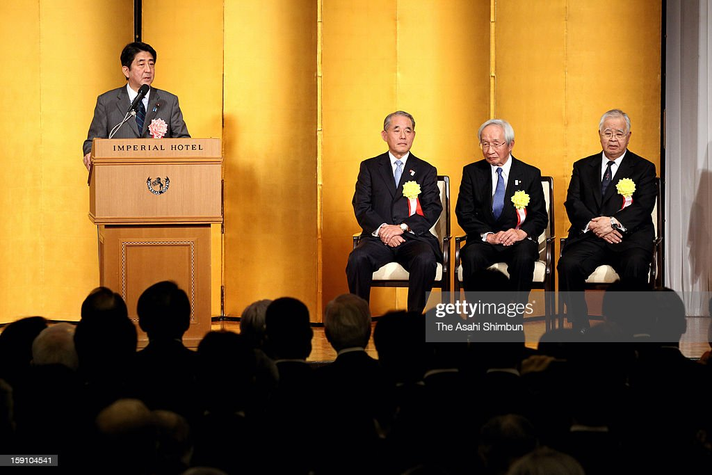 Japanese Prime Minister <a gi-track='captionPersonalityLinkClicked' href=/galleries/search?phrase=Shinzo+Abe&family=editorial&specificpeople=559017 ng-click='$event.stopPropagation()'>Shinzo Abe</a> (1L) addresses while Japan Association of Corporate Executives chairman Yasuchika Hasegawa (2L), Japan Chamber of Commerce chairman Tadashi Okumura (2R) and Japan Business Federation chairman <a gi-track='captionPersonalityLinkClicked' href=/galleries/search?phrase=Hiromasa+Yonekura&family=editorial&specificpeople=2816307 ng-click='$event.stopPropagation()'>Hiromasa Yonekura</a> listen during their new year party at the Imperial Hotel on Janaury 7, 2013 in Tokyo, Japan.