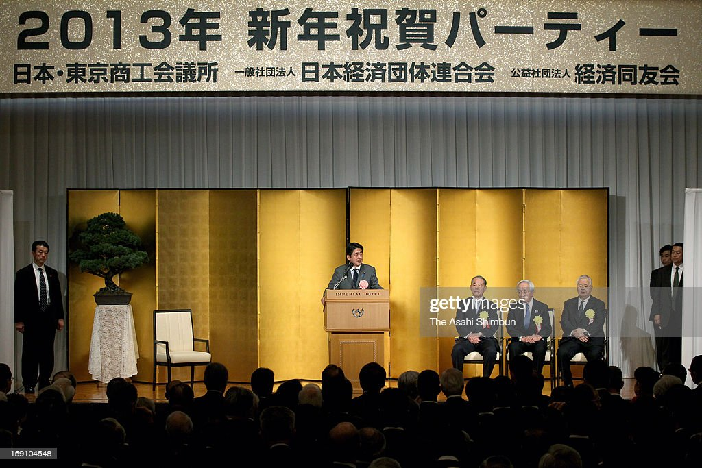 Japanese Prime Minister Shinzo Abe (1L) addresses while Japan Association of Corporate Executives chairman Yasuchika Hasegawa (2L), Japan Chamber of Commerce chairman Tadashi Okumura (2R) and Japan Business Federation chairman Hiromasa Yonekura listen during their new year party at the Imperial Hotel on Janaury 7, 2013 in Tokyo, Japan.