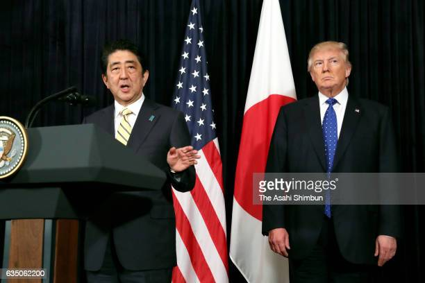 Japanese Prime Minister Shinzo Abe addresses while US President Donald Trump listens during a press conference after a North Korea's missile launch...