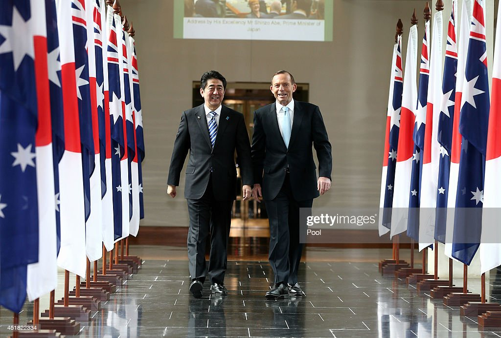 Japanese Prime Minister Shinzo Abe and Australian Prime Minister Tony Abbott depart the House of Representatives after Prime Minister Abe's address...