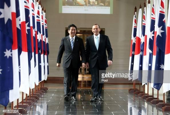 Japanese Prime Minister Shinzo Abe and Australian Prime Minister Tony Abbott depart the House of Representatives after Prime Minister Abe's address...