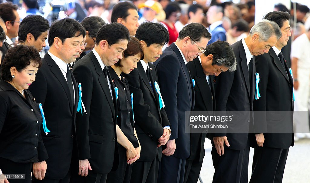 Japanese Prime Minister <a gi-track='captionPersonalityLinkClicked' href=/galleries/search?phrase=Shinzo+Abe&family=editorial&specificpeople=559017 ng-click='$event.stopPropagation()'>Shinzo Abe</a> (1R) and cabinet members attend the peace memorial to mark the 68th anniversary of the termination of the Battle of Okinawa at Okinawa Peace Memorial Park on June 23, 2013 in Itoman, Okinawa, Japan. During the 3-month ground battle at the end of World War II, more than 200,000 people were killed.