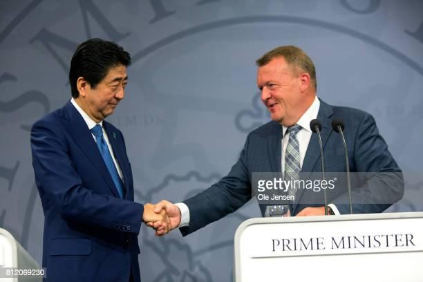 Japanese Prime Minister Shinzo Abe and Danish Prime Minister Lars Loekke Rasmussen shake hands at the PM's Office on July 10 2017 in Copenhagen...