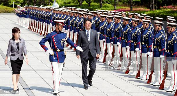 Japanese Prime Minister Shinzo Abe and Defense Minister Tomomi Inada review the honour guard prior to the JGSDF South Sudan Peaacekeeping Mission...