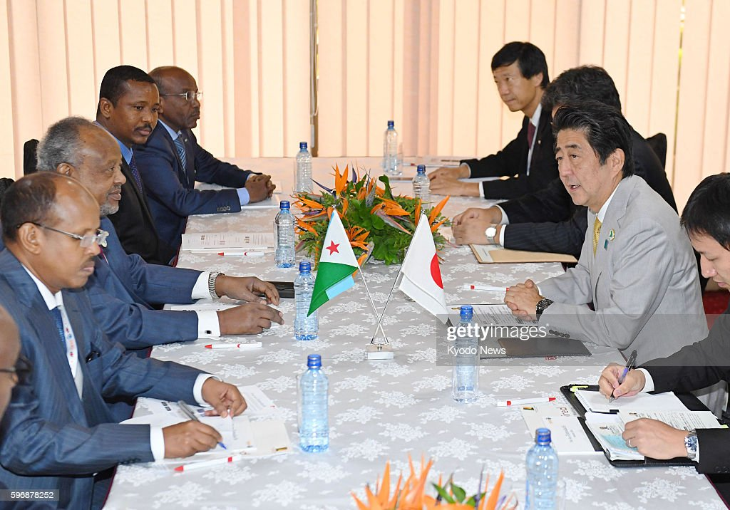 Japanese Prime Minister Shinzo Abe and Djibouti's President Ismail Omar Guelleh shake hands in Nairobi Kenya on Aug 28 as they hold talks on the...