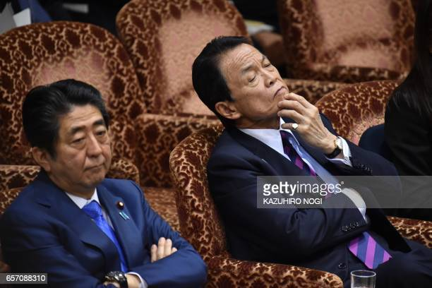 Japanese Prime Minister Shinzo Abe and Finance Minister Taro Aso attend a budget committee session of the House of Councilors at the Parliament in...