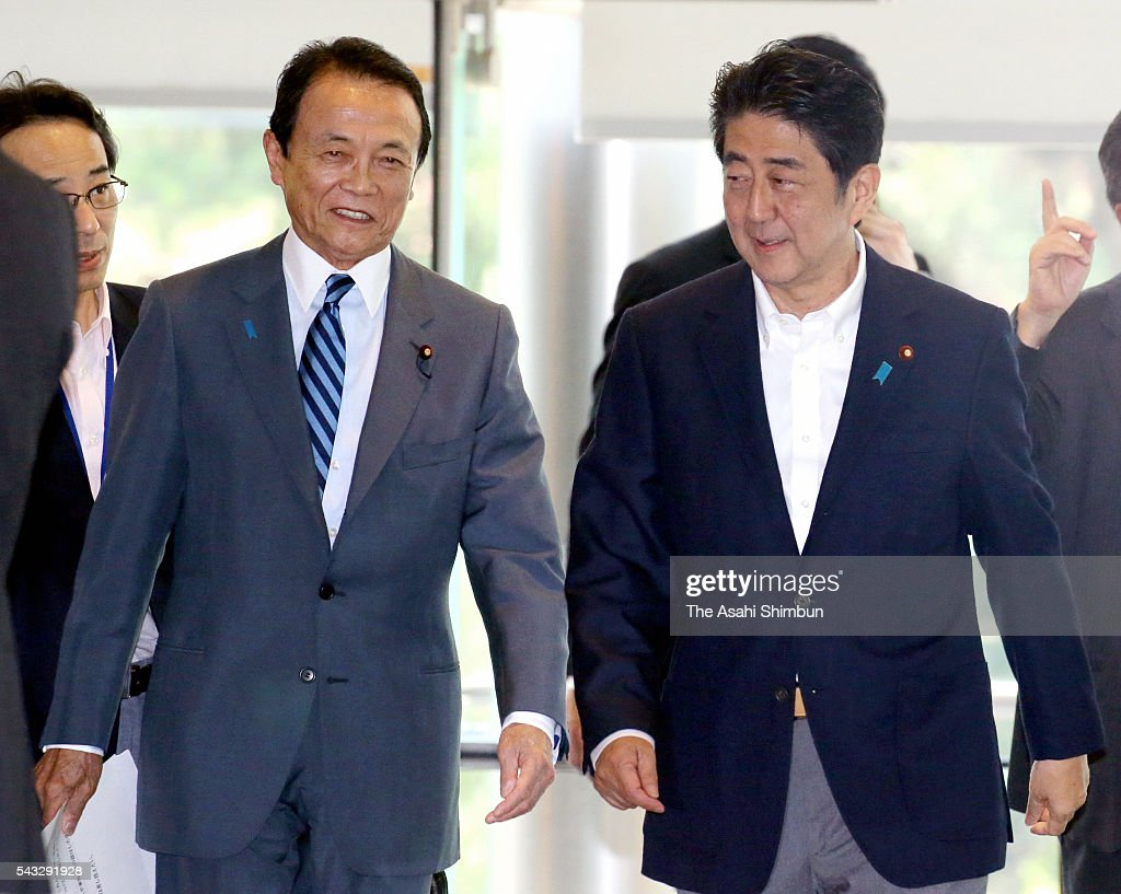 Japanese Prime Minister <a gi-track='captionPersonalityLinkClicked' href=/galleries/search?phrase=Shinzo+Abe&family=editorial&specificpeople=559017 ng-click='$event.stopPropagation()'>Shinzo Abe</a> (R) and Finance Minister <a gi-track='captionPersonalityLinkClicked' href=/galleries/search?phrase=Taro+Aso&family=editorial&specificpeople=559212 ng-click='$event.stopPropagation()'>Taro Aso</a> (L) are seen ahead of their meeting with the Bank of Japan Deputy Governor Hiroshi Nakaso at Abe's official residence on June 27, 2016 in Tokyo, Japan. The government and the central bank held a meeting to measure the impact of the 'Brexit'.