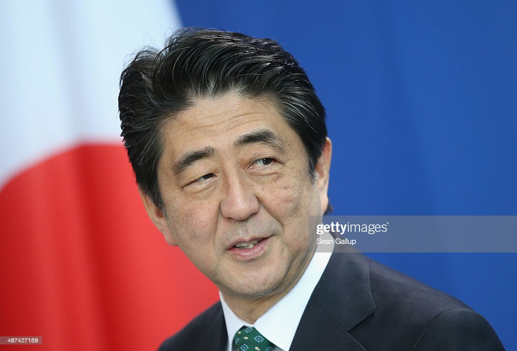 Japanese Prime Minister <a gi-track='captionPersonalityLinkClicked' href=/galleries/search?phrase=Shinzo+Abe&family=editorial&specificpeople=559017 ng-click='$event.stopPropagation()'>Shinzo Abe</a> and German Chancellor Angela Merkel (not pictured) speak to the media following talks at the Chancellery on April 30, 2014 in Berlin, Germany. The two leaders are meeting on a variety of issues, including the current crisis in eastern Ukraine.