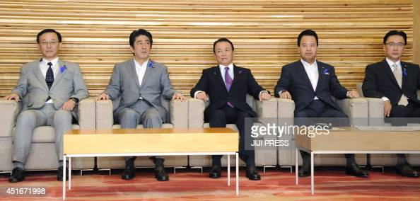 Japanese Prime Minister Shinzo Abe and his cabinet members Minister for Justice Sadakazu Tanigaki Minister for Finance Taro Aso Minister of State for...