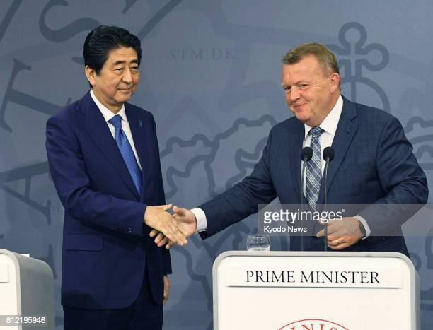 Japanese Prime Minister Shinzo Abe and his Danish counterpart Lars Loekke Rasmussen shake hands after a joint press conference in Copenhagen on July...