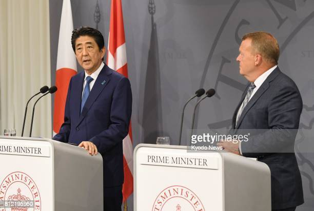 Japanese Prime Minister Shinzo Abe and his Danish counterpart Lars Loekke Rasmussen give a joint press conference in Copenhagen on July 10 2017 They...