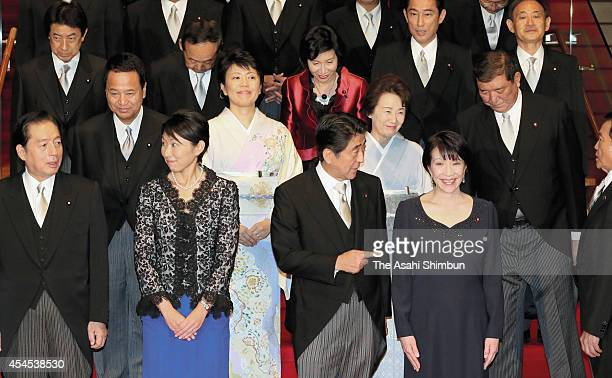 Japanese Prime Minister Shinzo Abe and his new Cabinet members Land Infrastructure Transport and Tourism Minister Akihiro Ota Trade Minister Yuko...