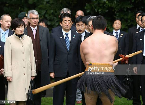 Japanese Prime Minister Shinzo Abe and his wife Akie Abe are given a traditional Maori welcome at Government House on July 7 2014 in Auckland New...
