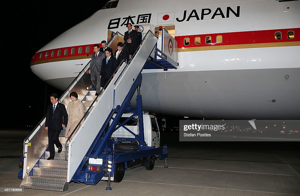 Japanese Prime Minister <a gi-track='captionPersonalityLinkClicked' href=/galleries/search?phrase=Shinzo+Abe&family=editorial&specificpeople=559017 ng-click='$event.stopPropagation()'>Shinzo Abe</a> and his wife <a gi-track='captionPersonalityLinkClicked' href=/galleries/search?phrase=Akie+Abe&family=editorial&specificpeople=2042808 ng-click='$event.stopPropagation()'>Akie Abe</a> arrive at Fairburn Airbase on July 7, 2014 in Canberra, Australia. Prime Minister Abe is in Australia for three days and will sign a Economic Partnership Agreement with Australia. Japan is Australia's second biggest trading partner.