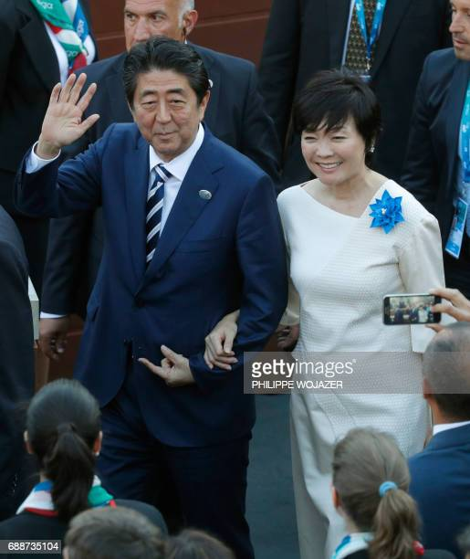 Japanese Prime Minister Shinzo Abe and his wife Akie Abe arrive to attend a concert of the La Scala Philharmonic Orchestra during the Summit of the...