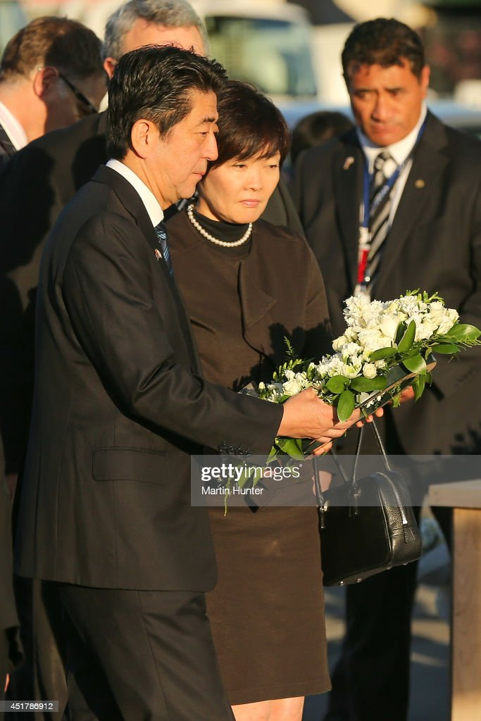 Japanese Prime Minister <a gi-track='captionPersonalityLinkClicked' href=/galleries/search?phrase=Shinzo+Abe&family=editorial&specificpeople=559017 ng-click='$event.stopPropagation()'>Shinzo Abe</a> and his wife <a gi-track='captionPersonalityLinkClicked' href=/galleries/search?phrase=Akie+Abe&family=editorial&specificpeople=2042808 ng-click='$event.stopPropagation()'>Akie Abe</a> lay a wreath at the CTV site on July 7, 2014 in Christchurch, New Zealand. Prime Minister Abe is in Christchurch to pay his respects to the 28 Japanese citizens who lost their lives in the February 2011 earthquake. Abe was in Auckland this morning to have talks with Prime Minister John Key on the Trans-Pacific Partnership agreement.