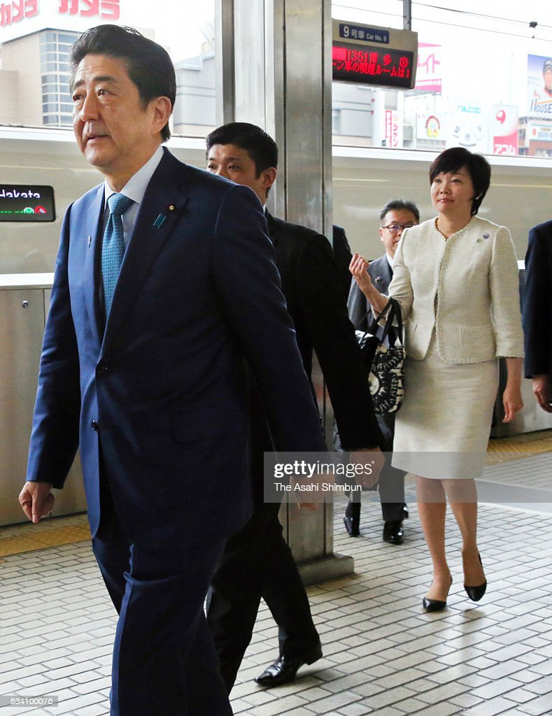 Japanese Prime Minister <a gi-track='captionPersonalityLinkClicked' href=/galleries/search?phrase=Shinzo+Abe&family=editorial&specificpeople=559017 ng-click='$event.stopPropagation()'>Shinzo Abe</a> (L) and his wife Akie (R) are seen on arrival at the Nagoya Station on the way to Shima to the Group of Seven summit on May 25, 2016 in Nagoya, Aichi, Japan. The Group of Seven summit takes place on May 26 and 27 to discuss key global issues such as global economy and anti terrorism measures.