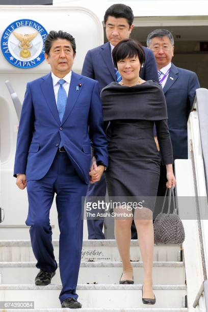 Japanese Prime Minister Shinzo Abe and his wife Akie are seen on arrival at Heathrow Airport on April 28 2017 in London England Abe is on a fourday...