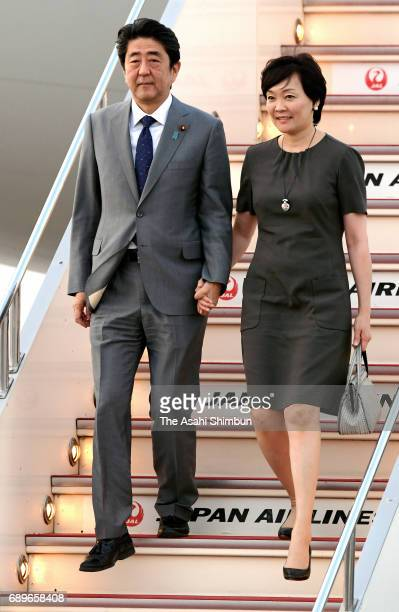 Japanese Prime Minister Shinzo Abe and his wife Akie are seen on arrival at Haneda International Airport on May 26 2017 in Tokyo Japan Abe attended...