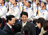 Japanese Prime Minister Shinzo Abe and his wife Akie are welcomed by Vietnamese Prime Minister Nguyen Tan Dung during the welcome ceremony at the...