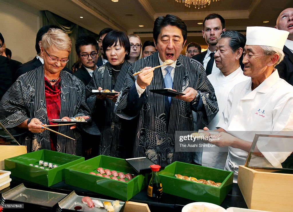 Japanese Prime Minister <a gi-track='captionPersonalityLinkClicked' href=/galleries/search?phrase=Shinzo+Abe&family=editorial&specificpeople=559017 ng-click='$event.stopPropagation()'>Shinzo Abe</a> (C) and his wife Akie (2L) eat Sushi to promote the Japanese food and its safety ahead of the V4+Japan Prime Ministers Meeting on at a hotel on June 15, 2013 in Warsaw, Poland. Abe is on tour to Europe to attend the summit meeting with V4 group (Czech Republic, Hungary, Poland and Slovakia), G8 Summit, followed by the first ever visit to Ireland as Japanese Prime Minister.