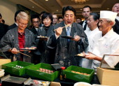 Japanese Prime Minister Shinzo Abe and his wife Akie eat Sushi to promote the Japanese food and its safety ahead of the V4Japan Prime Ministers...