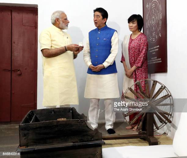 Japanese Prime Minister Shinzo Abe and his wife Akie listen to explanation by Indian Prime Minister Narendra Modi at Sabarmati Ashram on September 13...