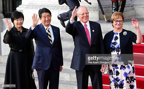 Japanese Prime Minister Shinzo Abe and his wife Akie Peruvian President Pedro Pablo Kuczynski and his wife Nancy Lange wave during the welcome...
