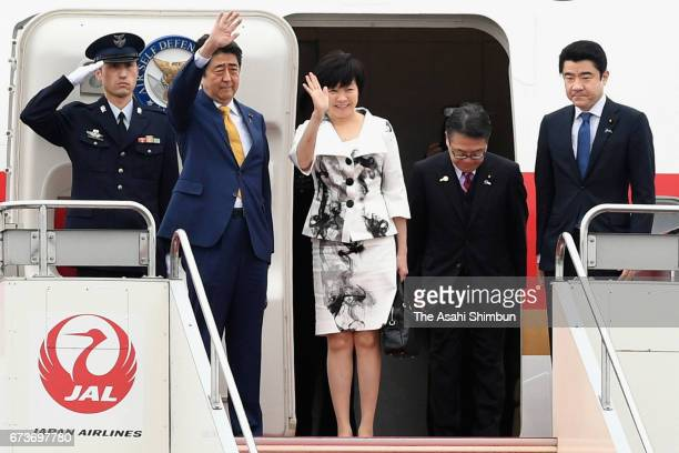 Japanese Prime Minister Shinzo Abe and his wife Akie wave on departure at Haneda International Airport on April 27 2017 in Tokyo Japan Abe is on a...
