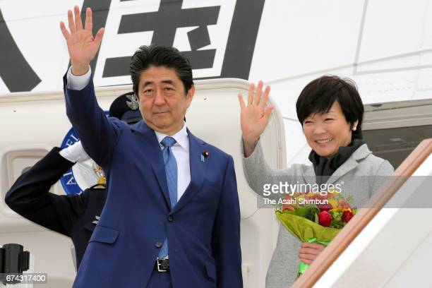 Japanese Prime Minister Shinzo Abe and his wife Akie wave on departure at Vnukovo International Airport on April 28 2017 in Moscow Russia Abe is on a...