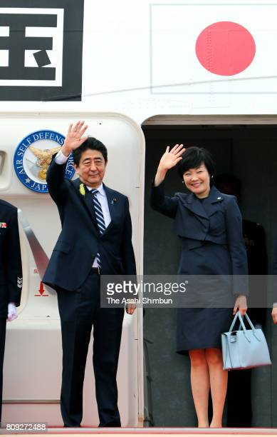 Japanese Prime Minister Shinzo Abe and his wife Akie wave on departure for Europe at Haneda International Airport on July 5 2017 in Tokyo Japan Abe...