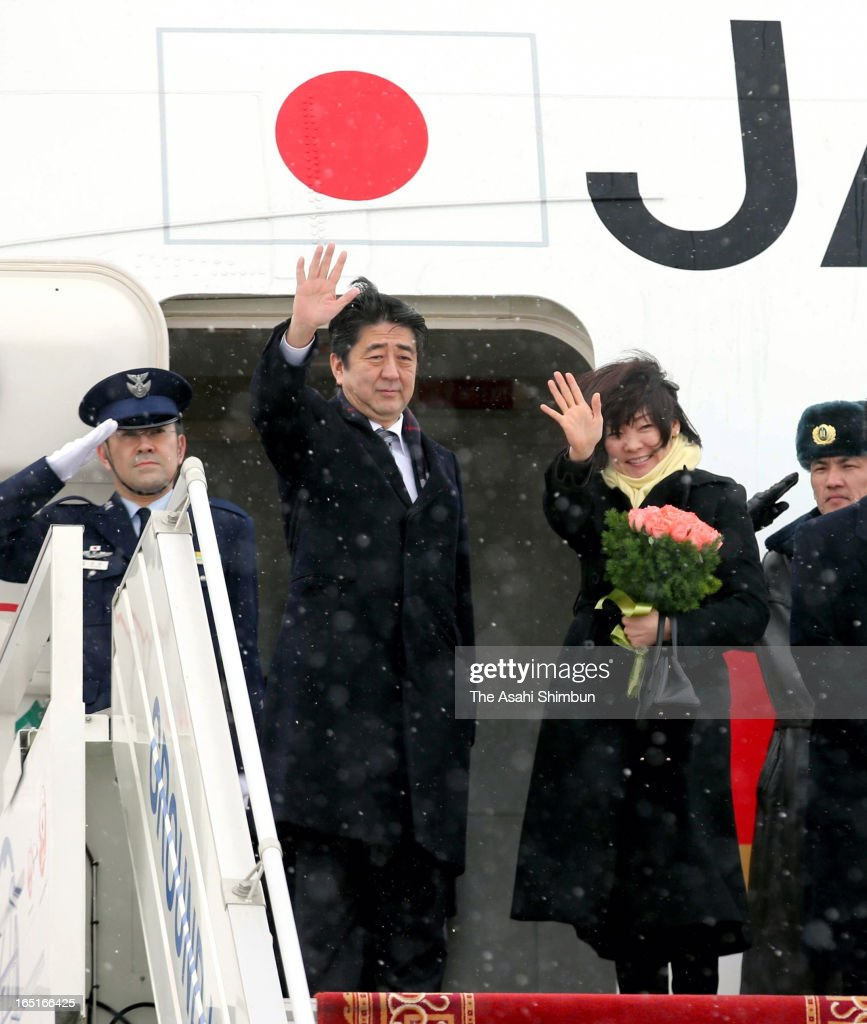 Japanese Prime Minister Shinzo Abe and his wife Akie wave on departure for Japan on March 31, 2013 in Ulan Bator, Mongolia. Abe is on two-day tour to Mongolia to strengthen their bilateral relationship.