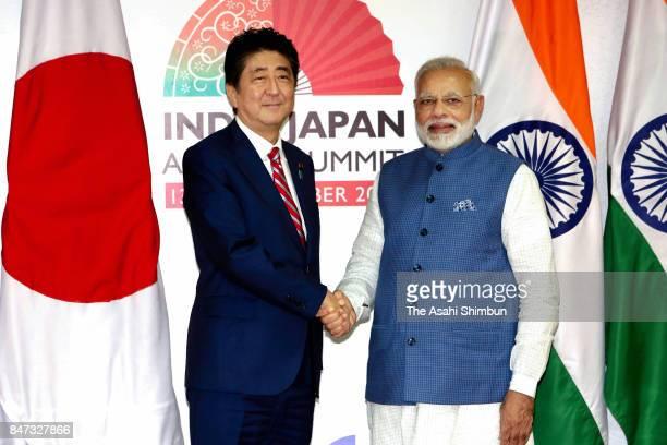 Japanese Prime Minister Shinzo Abe and Indian Prime Minister Narendra Modi shake hands prior to their meeting on September 14 2017 in Gandhinagar...
