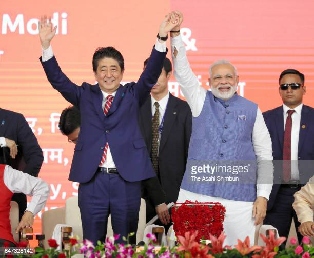 Japanese Prime Minister Shinzo Abe and Indian Prime Minister Narendra Modi attend the groundbreaking ceremony of the high speed train project using...