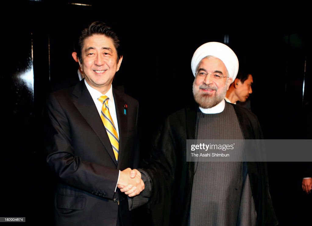 Japanese Prime Minister <a gi-track='captionPersonalityLinkClicked' href=/galleries/search?phrase=Shinzo+Abe&family=editorial&specificpeople=559017 ng-click='$event.stopPropagation()'>Shinzo Abe</a> and Iranian President Hassan Rouhani shake hands during their meeting on the sidelines of the 68th United Nations General Assembly session on September 26, 2013 in New York. Abe urges Rouhani to resolve their nuclear issues quickly.