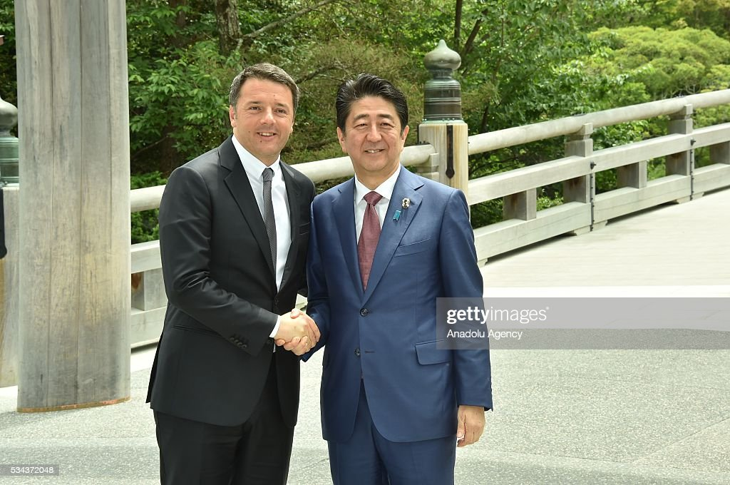 Japanese Prime Minister Shinzo Abe (R) and Italian Prime Minister Matteo Renzi (L) shake hands prior to G7 leaders summit at the Ise Jingu (Shrine) on May 26, 2016 in Ise, Mie Prefecture, Japan.