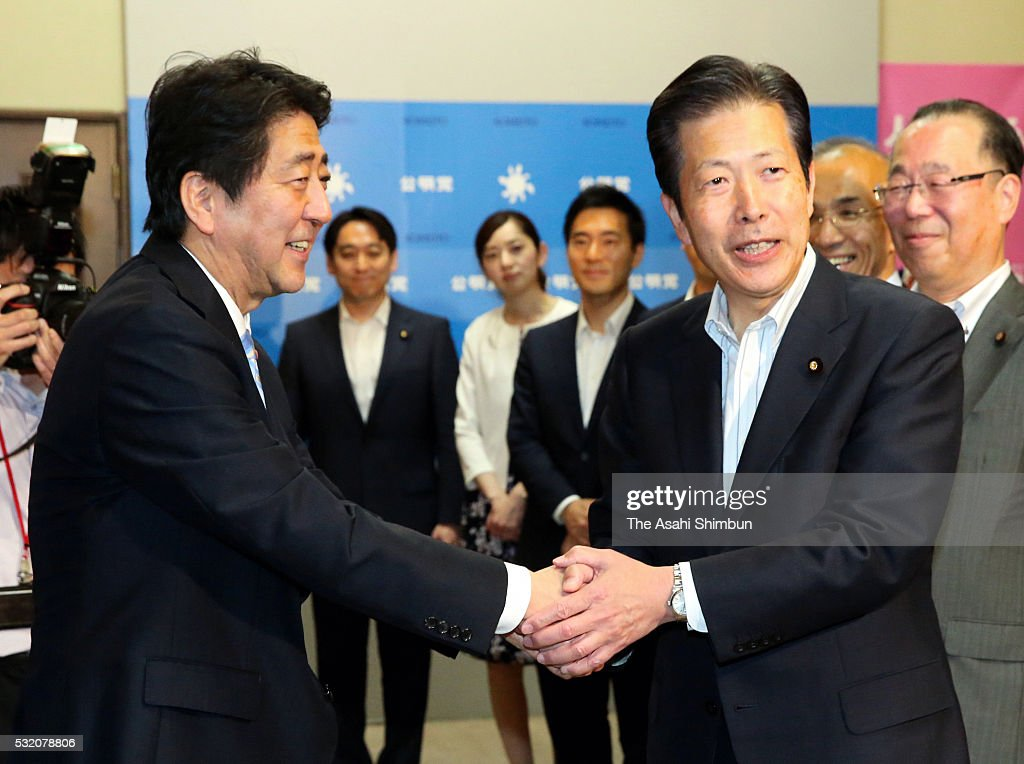 Japanese Prime Minister <a gi-track='captionPersonalityLinkClicked' href=/galleries/search?phrase=Shinzo+Abe&family=editorial&specificpeople=559017 ng-click='$event.stopPropagation()'>Shinzo Abe</a> (L) and junior coalition Komeito leader <a gi-track='captionPersonalityLinkClicked' href=/galleries/search?phrase=Natsuo+Yamaguchi&family=editorial&specificpeople=5718603 ng-click='$event.stopPropagation()'>Natsuo Yamaguchi</a> (R) shake hands as the supplementary budget of the support for Kumamoto earthquake damage was unanimously passed at the Upper House plenary session at the diet building on May 17, 2016 in Tokyo, Japan. The supplementary budget, a 778 billion Japanese yen, was enacted and will be used to support the earthquakes damaged areas.